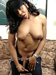 Black tranny getting some white cock in her