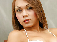 tiny ladyboy with beautiful eyes and a baby face shows off her awesome body