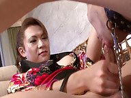 Japanese newhalf Reina blows smoke in her submissive slaves face before sitting on it