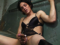 Foxi shows off her big cock wrapping it in leather