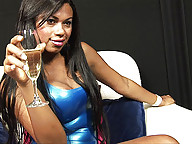 Ebony shemale strips and strokes her big cock
