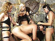 Three shemale dommes have their way with this slave