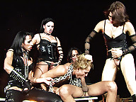 Guy is chained and abused by horny shemales