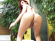 Redheaded tranny stroking her cock off
