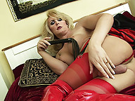 Sexy shemale in red latex getting wild solo