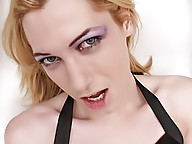 Skinny long haired tranny poses in leather