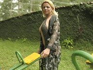 Tranny slut shoots load outside