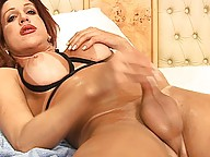 oiled shemeat gets stroked hard and fast