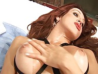 Redheaded shemale squirts lotion on her shecock