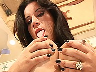 Horny shemale strokes her shecock with lotion