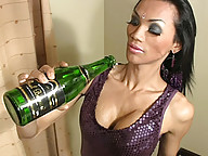 Horny ladyboy toys ass with wine bottle