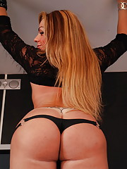 Shemale in black lace spreads ass cheeks