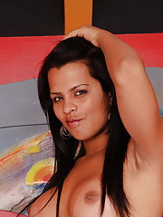 Pretty Latin tranny plays with her shecock