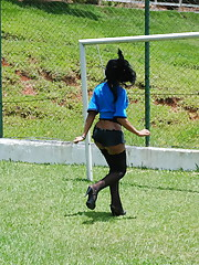 Hot T-girl plays on soccer field