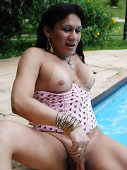 Horny shemale stroking her girl meat