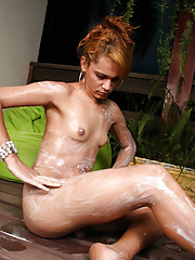 Shemale whore spreading lotion on her body