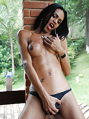 Sultry dark skinned shemale gets naked