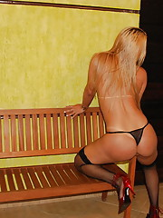 Blonde T-girl strips out of lingerie