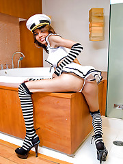 Uniformed dick-girl sailing in a sizeable bathtub