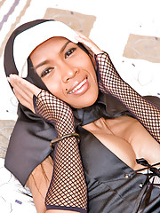 Sexy shemale dressed like a nun shows her goodies