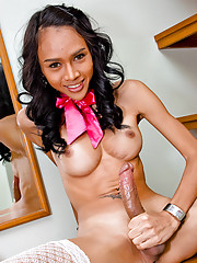 Pretty shemale in a sailor uniform getting naughty