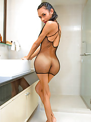 Extra hung ladyboy in a net dress in the bathroom