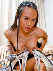 Lusty ladyboy wearing a pair of hot stiletto heels