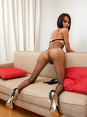 Fishnet clad tranny fully indulges her foot fetish