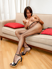 Kinky t-girl licks and stuffs a gold stiletto heel