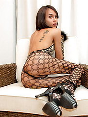 Hung tranny curls up in a leopard teddy and gloves