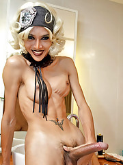 Dolled up diva Mint strips and strokes her salami