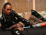 T-girl in fancy attire drilled by a mechanical rod