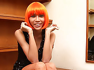 Passionate ladyboy in a bright red wig going wild