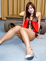 Asian t-girl Aum makes her dick stand at attention