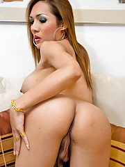 Busty ladyboy Valencia gives her pecker a workout