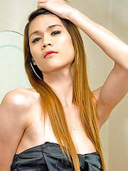 Leggy ladyboy Toy clad in a short black silky gown