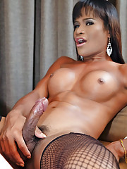 Fit ladyboy fighter flexes cock muscle
