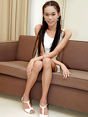 Lanky ladyboy love machine plays with herself