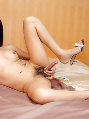 Oriental tgirl Pem exposes her smooth-skinned body