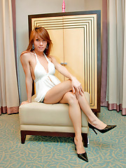 Asian ladyboy Minty gets naughty with a butt plug