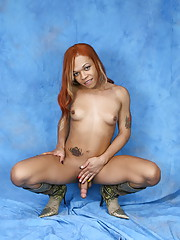 Sweet transsexual Candi Love posing in sexy boots