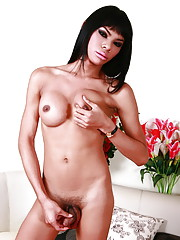 Exotical brunette Judy stripping and posing