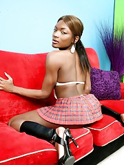 Ebony goddess Amyiaa posing as a naughty schoolgirl