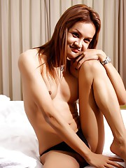 Cute transsexual stripping and posing