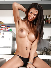 Lovely transsexual Nataly stripping in kitchen