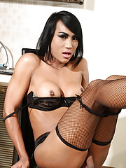 Exotical tgirl Amy posing her hard cock in the kitchen