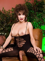 Gothic transsexual Kourtney posing her huge hard cock