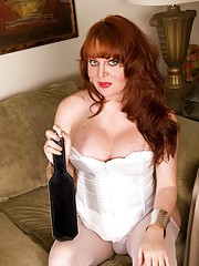 Busty seductive transsexual redhead posing