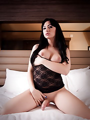 Irresistible TS Bailey Jay stripping on the bed