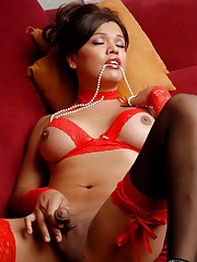 Irresistible TS Carmen Moore posing with pearls